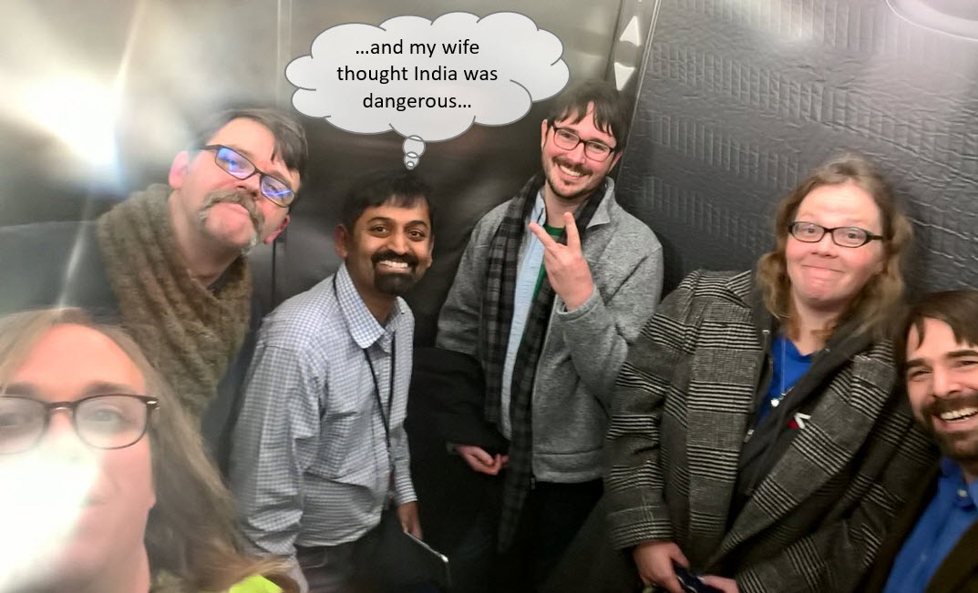 Vedu is trapped in an elevator with his coworkers.